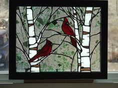 Cardinals in Spring - I made this panel for a good friend, whose family has helped mine many times. Cardinals are her favorite birds. I used Fractures glass for the background. Design and image copyright © by Ladybug Stained Glass.