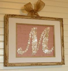 Framed Button Monogram.  Print a letter on your printer, and glue on various size buttons. Voila!