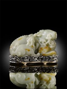 An Exceptional and Extremely Rare Large Chinese Imperial White Jade Carving of a Recumbent Deer with its Young, Qing dynasty, Qianlong period 1736-95.