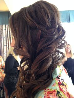 Side swept hair with waterfall braid soft curls