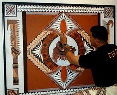 Artist Fa'amasani Puletasi puts some finishing touches to this artwork with a Samoan/Polynesian theme to it. As you can see, there's a kava bowl and whisk (fue) in the middle, surrounded by various Nesian designs. On the left, is the Samoan war-club and on the right is the Samoan knife.