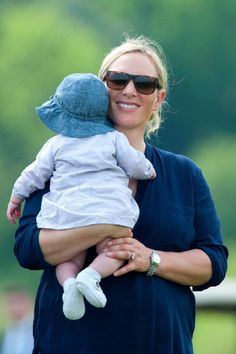 queensofias: Zara Phillips and daughter Mia Tindall, attended the Mike Tindall CelebrityGolf Classic to support Rugby for Heroes, May 19, 2014