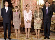 Chic: Princess Letizia is glamorous in a tweed two-piece in this royal family photo with Infanta Elena, Infanta Cristina and Iñaki Urdangarin, Duke of Palma de Mallorca