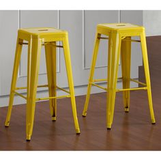 With their sturdy steel construction, these Tabouret 30-inch bar stools are offered in a lemon yellow color. These sturdy 100-percent steel stools are fully assembled, stackable and scratch and mar resistant.