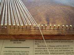 double wrap the string around each outline nail to make it more secure - diy string-art state boards