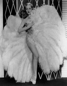 1920's burlesque queen Sally Rand with her famous ostrich feather fans.