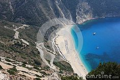Photo about Wonderful sunny summer day at Myrtos Beach in Kefalonia Island in the western side of Greece, at the Ionian Sea. Image of seafront, sunny, water - 35304156 Myrtos Beach, Greece Islands, Summer Days, Sunnies, Mount Rushmore, Westerns, Sea, Stock Photos, Mountains