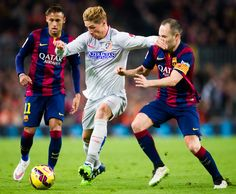 Fernando Torres of Club Atletico de Madrid fights for the ball with Andres Iniesta of FC Barcelona during the La Liga match between FC Barcelona and Club Atletico de Madrid at Camp Nou on January 11, 2015 in Barcelona, Catalonia.