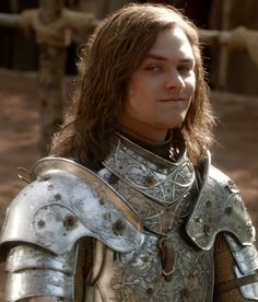 Loras Tyrell is Mace Tyrell's third son. He is one of the most famous knights in Westeros, and is known for his beauty and his fighting abilities. Loras was the secret lover of Renly Baratheon, and was the head of his Rainbow Guard. After Renly's death, Loras joined the Kingsguard and is greatly admired by King Tommen. When he volunteered to besiege Dragonstone, Cersei obliges, hoping he gets injured. Indeed, he wins the battle, but is grievously injured and his status unknown.