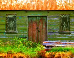 Old character hut at Rannoch Railway Station. I just love the art-work windows. by me 2014.
