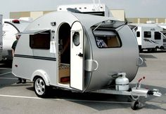 "This is a fairly complete look at the 2006 T@B camper with the ""clamshell"" floor plan. That is, the rear of the trailer opens up and the kitchen is in the ..."