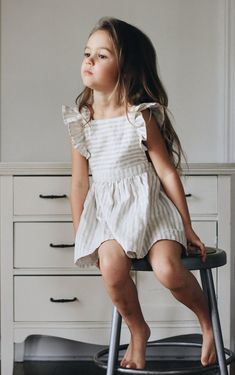 This season Daughter channels the carefree feel of years gone by. Playful rompers and free spirited flou dresses in a fresh palette of blues, bone, blush and off whites offset by soft ginghams and casual block cottons in gauze textures. The pieces in thi Little Girl Outfits, Little Girl Fashion, Toddler Fashion, Toddler Outfits, Child Fashion, Fashion Wear, Cute Kids Outfits, Kids Fashion Summer, Little Girl Style