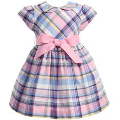 Baby girls very pretty short sleeved dress byRalph Lauren. Made from a soft, lightweight cotton it has all over pale pink, blue and yellow check.With a soft lining and gathered waist, it has a full shape, full covered button fastening down the back and a pale pink, ribbon sash that can be tied with a bow at the back or front. It comes with matching knickers, ideal for covering unsightly nappies.<br /> <ul> <li>100% cotton (soft feel)</li> <li>Full cotton lining</li> <li>Machine wash…