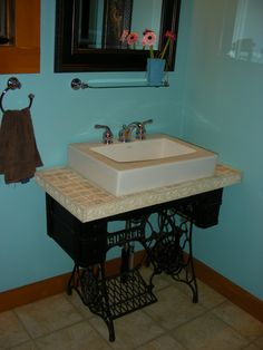 My husband remade our old singer sewing machine into our new sink. the idea did come from our friend Julie G.