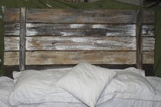 I would love to use a similar headboard for stringing pictures at the wedding.  Very rustic and pretty.