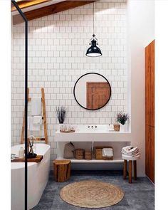round mirrors and square white tiles