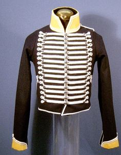 "In 1813, the 19th still had the old pattern uniform hussar-style uniform with Tarleton helmets. Replica uniform of the British 19th Light Dragoons, circa 1812, front view.  (Fort York, Toronto). Before 1812, the regulation Light Dragoon uniform consisted of a leather, bearskin-crested, ""Tarleton"" helmet and a blue jacket heavily braided with hussar-style cords."