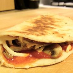 """What to do with the end of your homemade dough? This is an """"italian"""" taco made by grilling the dough in a sautéed pan with the toppings on top (then fold over half way through cooking). This one is stuffed with mushrooms, onions, vegan steak, and daiya mozzarella."""