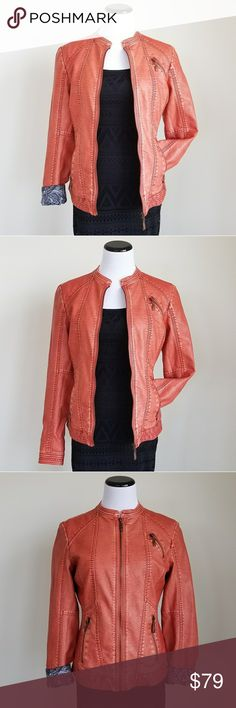 NWOT MontanaCo orange faux leather jacket Beautiful orange faux leather from The Montana Clothing Company.  This is unworn without tags (it is too big for me on the shoulders)  I included an image of a different color from their website and their size chart  This can be worn with sleeves rolled up or down!  Shell: 100% polyurethane laminated with 100% viscose Lining: 100% polyester Montana Co Jackets & Coats