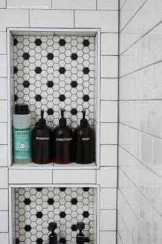 Love the honeycomb tile shelf inset with the subway tile shower. Such a pretty farmhouse bathroom renovation! #tilebathtub #bathroomrenovations