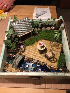 Custom Fairy Garden for client.  My first.  Used an old drawer we fortified. Hours of work but it was loved.  Yay!