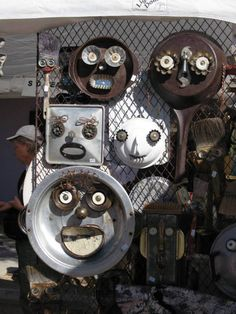 Garden faces in the scrap metal yard
