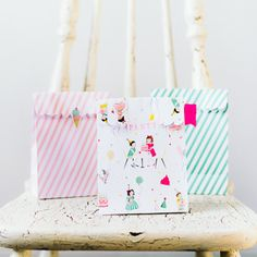 Pack up little party favors or homemade treats in these darling goodie bags, which feature polka dots, stripes, and vintage-inspired children's illustrations - Paper stand-up treat bags in 4 designs (