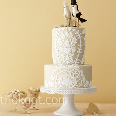 Loving this lace-like vintage style wedding cake. The cake toppper makes it!