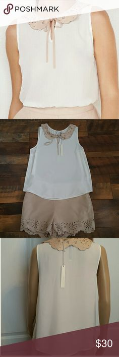 LC Lauren Conrad Faux Suede collar women's tank LC Lauren Conrad Faux Suede collar with eyelet details  women's tank. Sheer chiffon.  I have the matching shorts available both in medium size. Can be worn together or separate with any other items in your closet. LC Lauren Conrad Tops Tank Tops