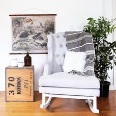 Bordeaux Rocking Chair by Hobbe Cement upholstery with white timber frame Image via Showroom