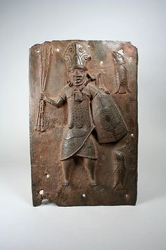 Plaque: Warrior and Fish, Edo peoples, Nigeria, Court of Benin, 16th-17th century. Metropolitan Museum of Art.