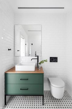 bathroom cabinets The focal point is the beautiful green vanity. My eyes then travel to the sink. I love how the sink and the toilet both are rounded, where everything else is more rectilinear. Bathroom Faucets, Bathroom Storage, Small Bathroom, Bathroom Ideas, Master Bathrooms, Bathroom Organization, Bathroom Mirrors, Farmhouse Bathrooms, Marble Bathrooms