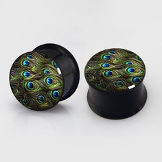 Hey, I found this really awesome Etsy listing at https://www.etsy.com/listing/189046712/peacock-feather-plugs-pairs-titanium