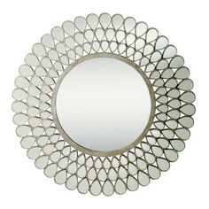 Pretty! Like the change from a rectangle mirror, but most pics show round mirrors with tall fireplaces. Hmmmm