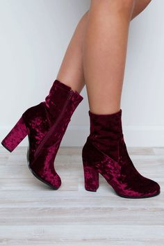Secure your status as a trend-setter in these Arlo Crushed Velvet Boots! Featuring a rich, ruby-colored crushed velveteen material. Side-zip closure, and a crushed velveteen covered stacked heel. Roun
