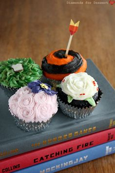 I have yet to jump on the Hunger Games craze, books OR movie, but I'm sure I'll cave soon. Especially with such allures as awesome and intriguing cupcakes. Find Hunger Games cupcakes HERE at Diamonds for Dessert