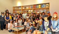 Candlewick staff wearing their favorite hats to celebrate We Found a Hat by Jon Klassen