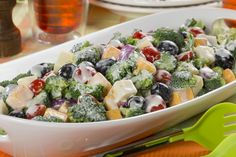 Need a fresh new idea for a go-along salad this season? Our Broccoli and Cheese Salad recipe fits the bill! This broccoli salad is sort of like a vegetarian antipasto, loaded with veggies and cheeses and topped off with an unforgettable, light and cr Broccoli Cauliflower, Broccoli And Cheese, Broccoli Salads, Broccoli Dishes, Fresh Broccoli, Broccoli Recipes, Vegetable Salad, Vegetable Recipes, Vegetable Dishes