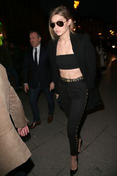 Fab: Gigi Hadid The leggy model turned heads in a pair of Versace high-waisted pants, black bandeau and a black coat. (Photo by Pierre Suu/Getty Images)                                     via @AOL_Lifestyle Read more: http://www.aol.com/article/2016/01/29/fab-or-flop-olivia-palermos-sporty-pants-diane-krugers-lace/21305017/?a_dgi=aolshare_pinterest#slide=3783617|fullscreen