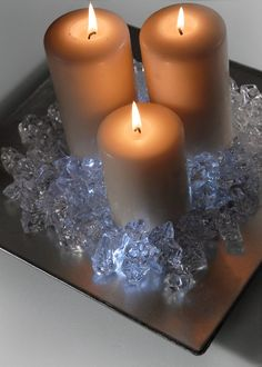 Use cheap chargers as candle holders for easy centerpieces. Add floralytes to gemstones for an extra touch.