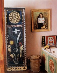 * Vanessa Bell bedroom at Charleston.  The bath was installed in the corner of Vanessa's bedroom in 1939; its panel decoration was carried out by Duncan in 1945; the Fountain& behind the taps was added after Vanessa died, in 1968. The hanging cupboard was decorated by Angelica in the late 1930s. Her daughter Nerissa, Vanessa and Duncan granddaughter, sat (rather glumly) for her portrait by Duncan in 1965. The chair she is sitting in is on the other side of ...