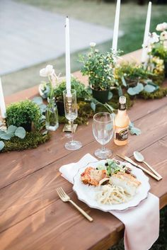 wood tables with candles and greenery #weddingdecor