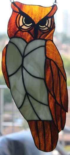 Stained Glass seated Owl that measures 12 inches tall and sells for $85. #StainedGlassOwl