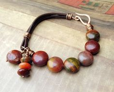Beaded Leather Bracelet Rust Olive Brown Chartreuse Orange Earthy Colors Petrified Wood Beads Bronze via Etsy.