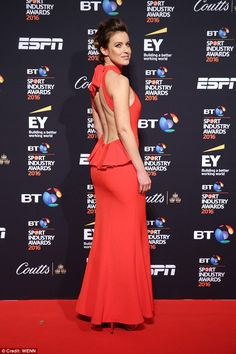 Stunning: The television presenter wowed in a backless red halterneck gown which she match...
