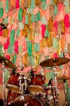 Paper garlands as a backdrop for the band. #weddings #paper #decoration #ideas