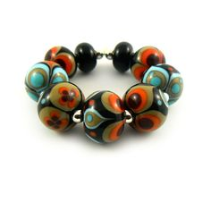 Hey, I found this really awesome Etsy listing at http://www.etsy.com/listing/130522484/handmade-lampwok-beads-black-sage-orange