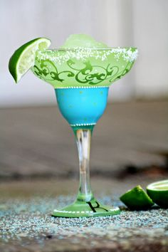 Our damask and dots margarita glass will have you counting the minutes to happy hour. 13oz glass, dishwasher safe, but we recommend hand washing.     Choose from monogram (shown), personalized, or triple monogram.