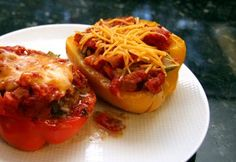 These stuffed peppers are filled with a mixture of ground beef, cheese, rice, tomatoes, garlic, herbs, and seasonings.