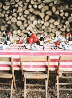 table setting. wood back drop, pomegranates, powder blue napkins, and striped table cloth. table settings, wood, rustic table, dinner parties, pomegranates, log, tabl set, backdrop, picnic